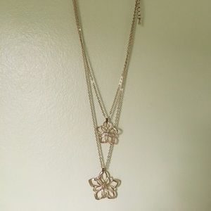 Charming Charlie gold double flower necklace.